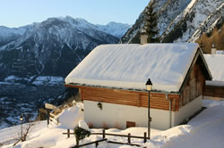 Swiss Chalet Covered In Snow
