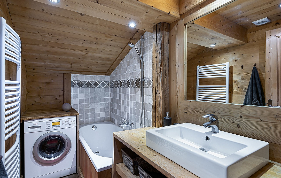 The bathroom with plumbing for washing machine