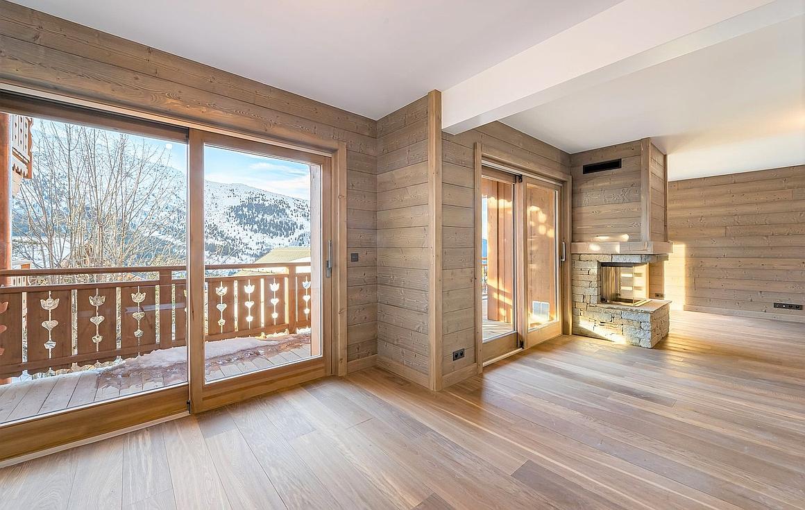 Open plan living area in Meribel apartment for sale