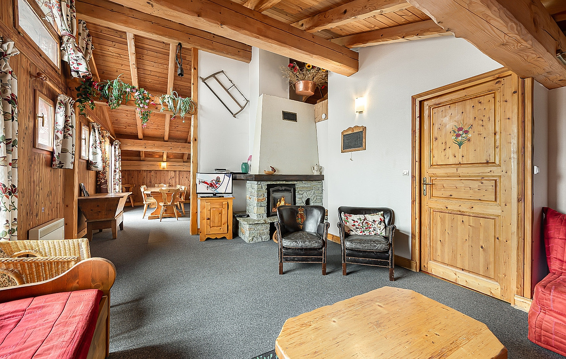 The living room in the La Tania chalet for sale