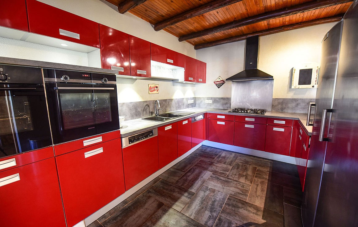 Large kitchen with two ovens and dishwashers