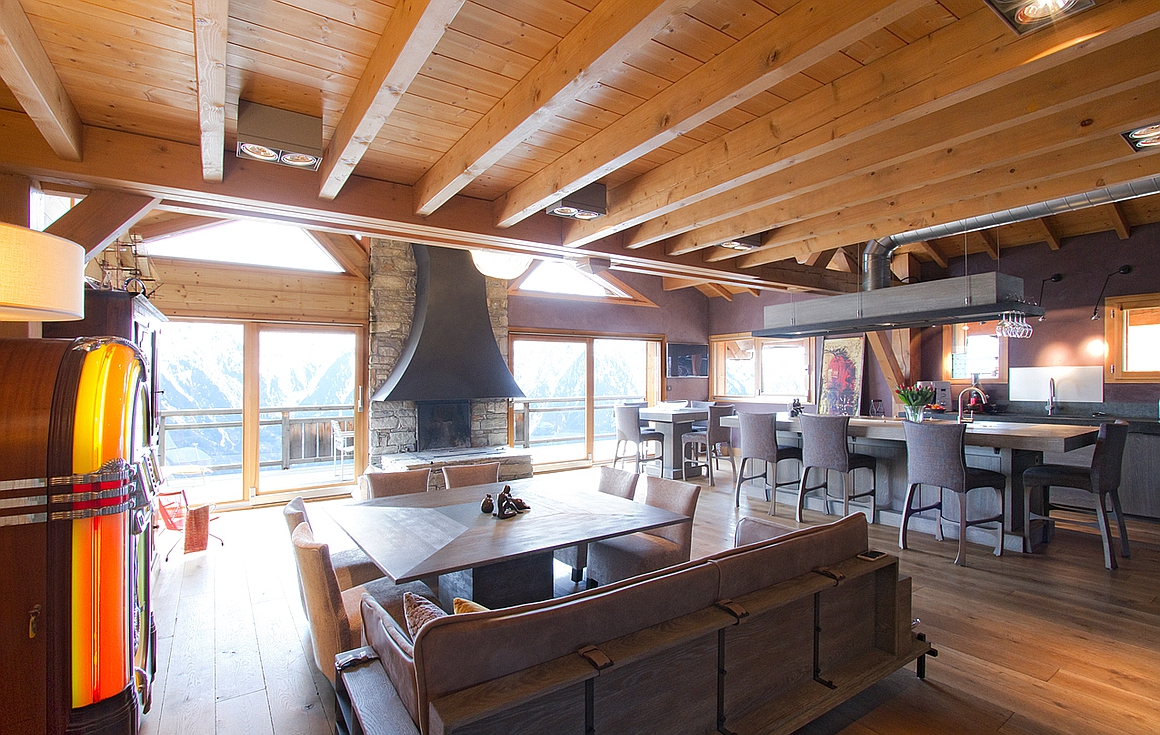 Living room of one of apartments for sale in Les Deux Alpes