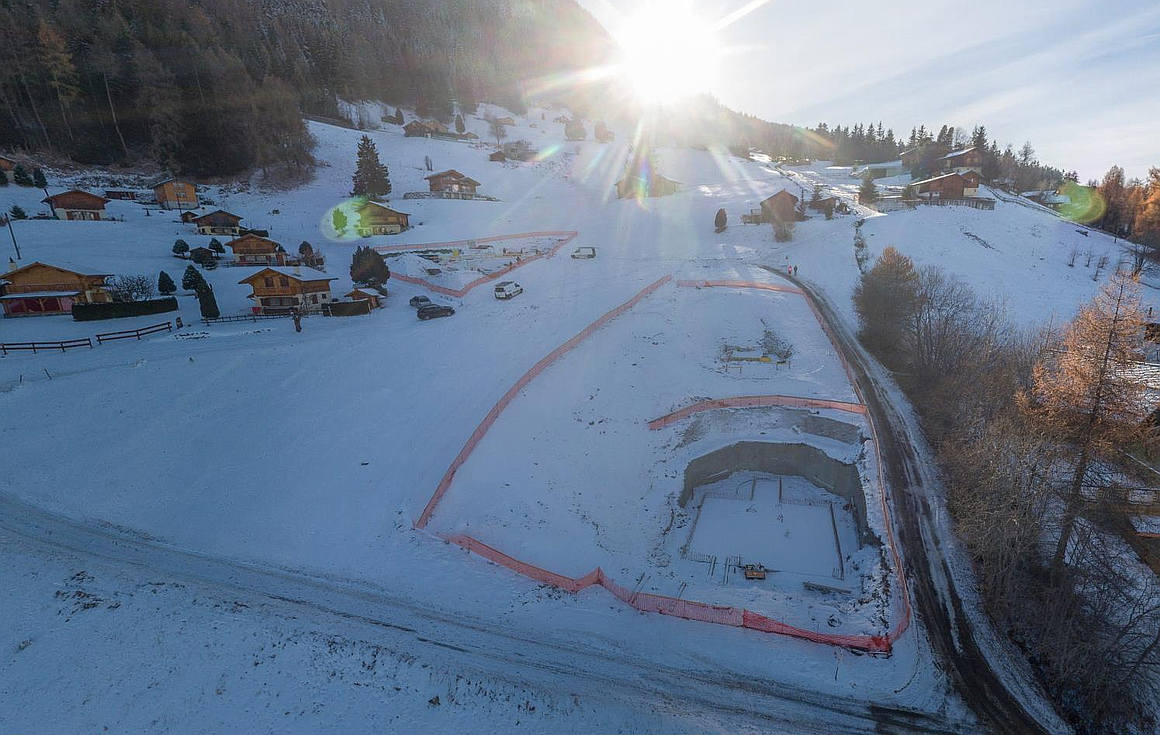 Chalets on the slopes under construction